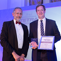 Sepura collecting award for Best Use Of Tetra In Utilities At International Tetra Awards