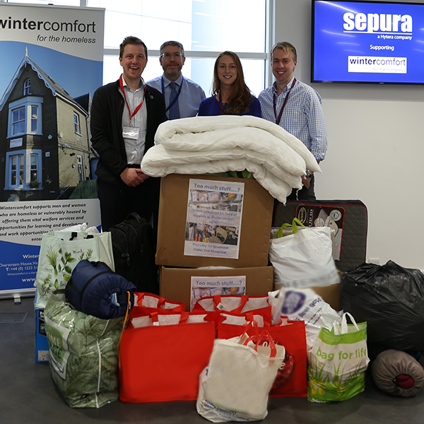 Sepura staff with donations made to Cambridge homeless charity Wintercomfort