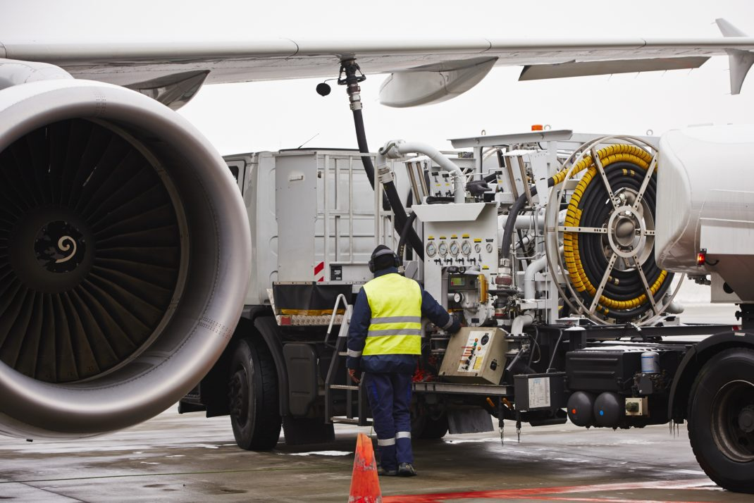 Airline maintenance workers carry out operational checks.